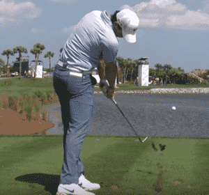 Rory McIlroy iron shot hit ball then ground hit behind ball hit golf ball first