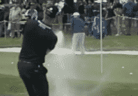 Henrik Stenson puts sand on the green out of the greenside bunker