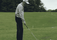 Justin Thomas moving golf ball to get a good lie at the driving range