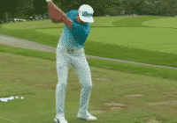 Rickie Fowler warming up for a round range balls alignment stick