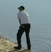 Bill Haas trying to get up and down by picking a target spot to land his chip shot