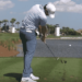 Rory McIlroy iron shot hit ball then ground